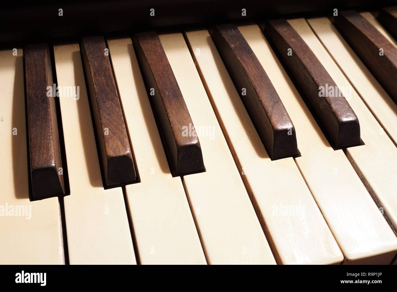 Close up of the wooden keys of an old pump organ - Stock Image