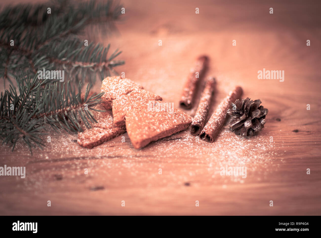 Cinnamon Christmas cookies and spices on wooden background - Stock Image