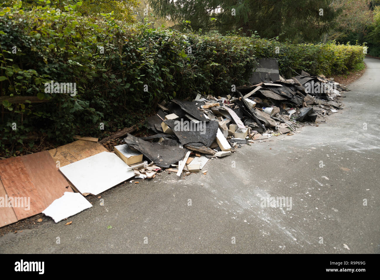 Flytipping waste down a country lane. - Stock Image