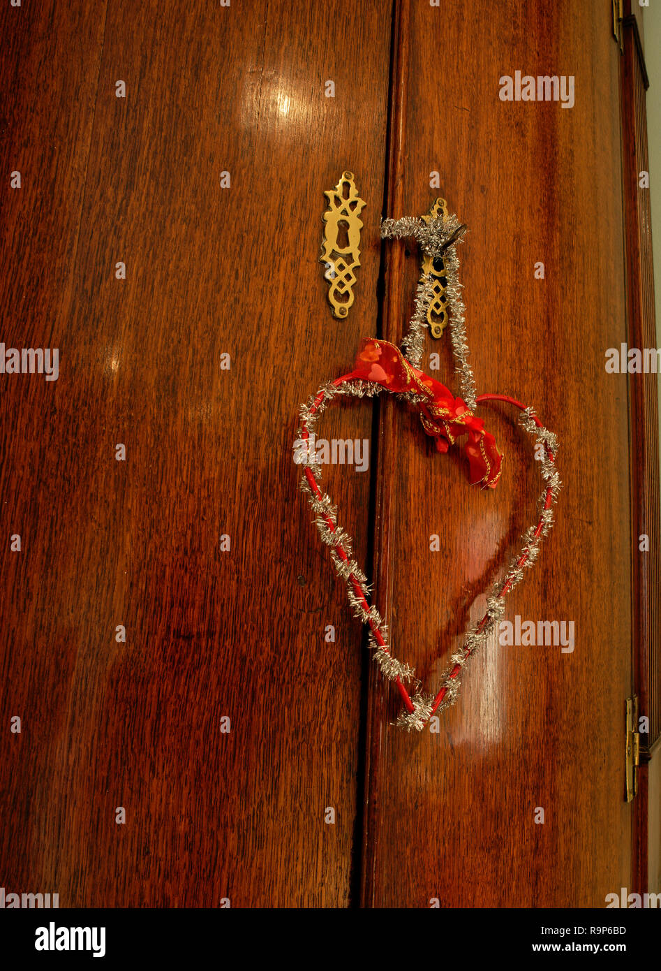 Tinsel heart to represent love at Christmas. - Stock Image