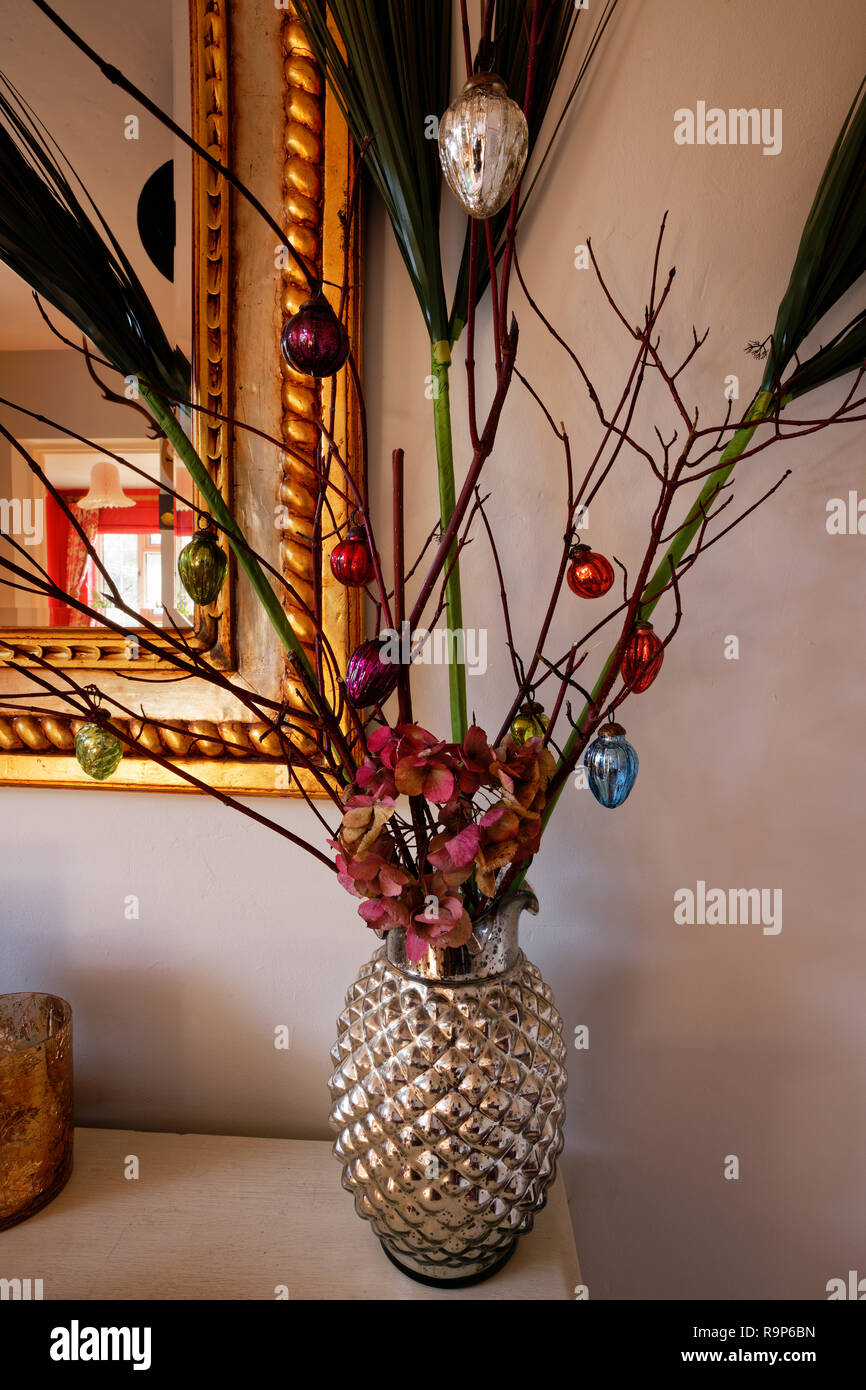 Modern Christmas twig tree with bauble decorations. - Stock Image