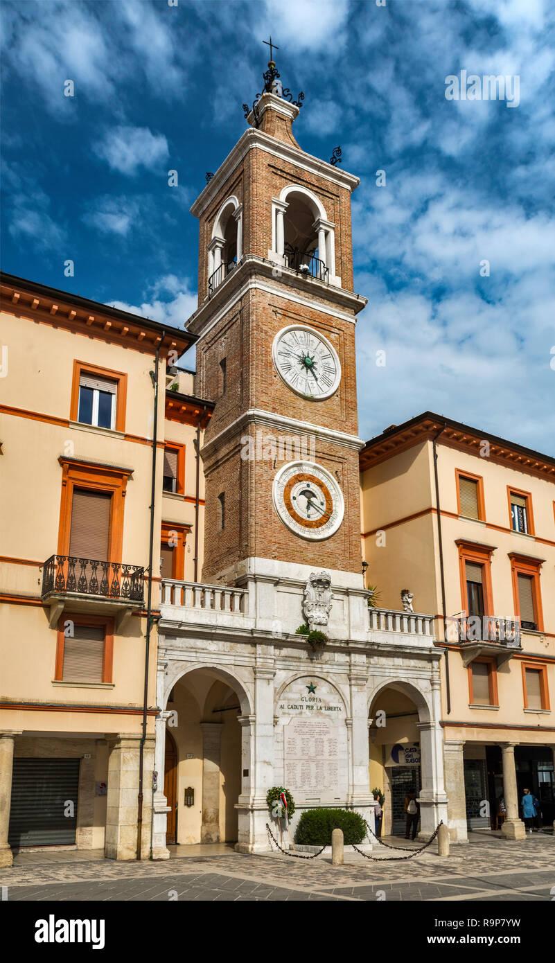 Clock tower over Gloria ai caduti per la liberta (Glory to the Fallen for Freedom) World War Two memorial in Rimini, Emilia-Romagna, Italy - Stock Image
