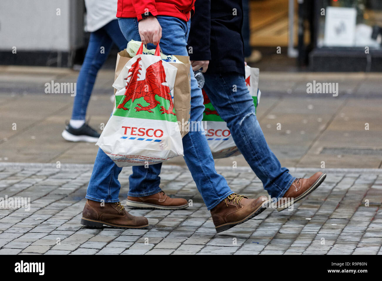 Last minute Christmas shoppers in Oxford Street, Swansea, Wales, UK. Monday 24 December 2018 - Stock Image