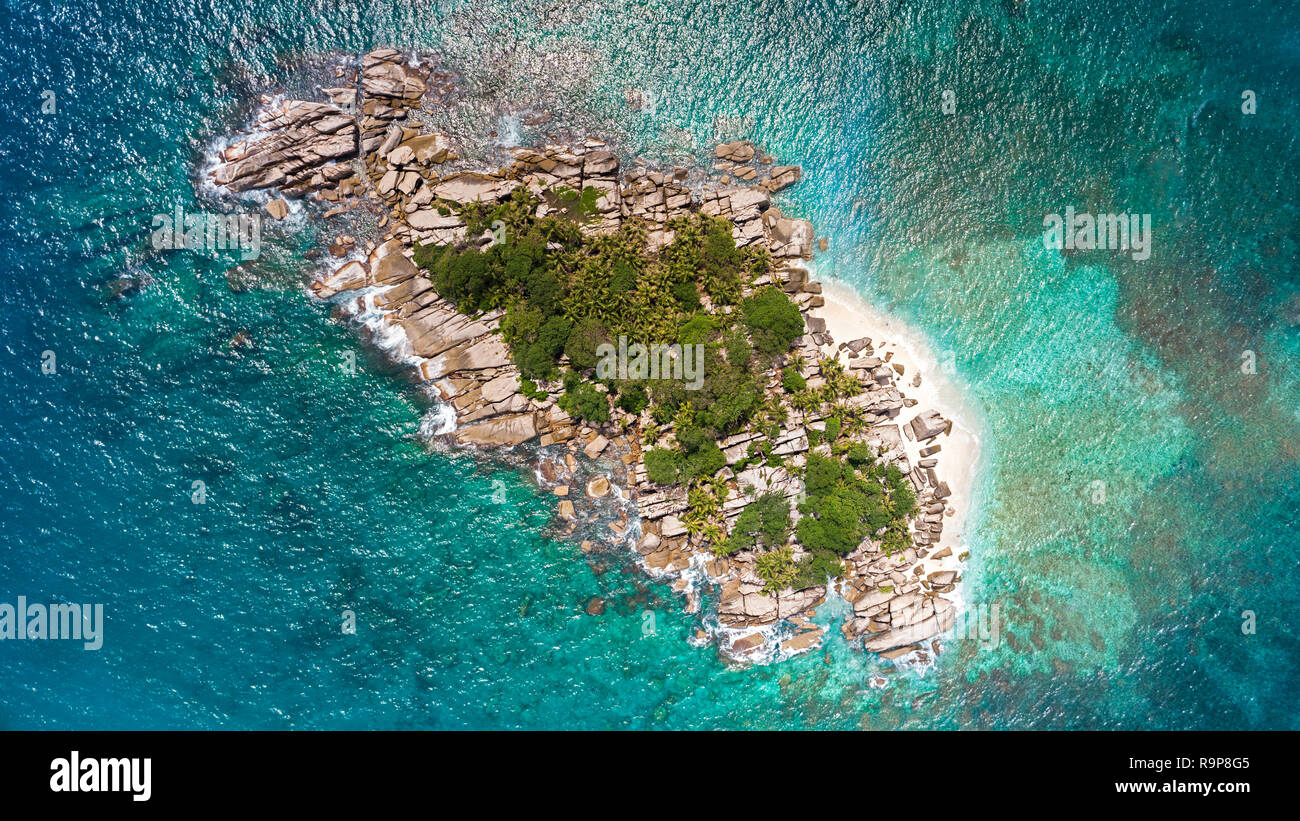 Tropical Seychelles aerial of island in sea. vacation concept. - Stock Image