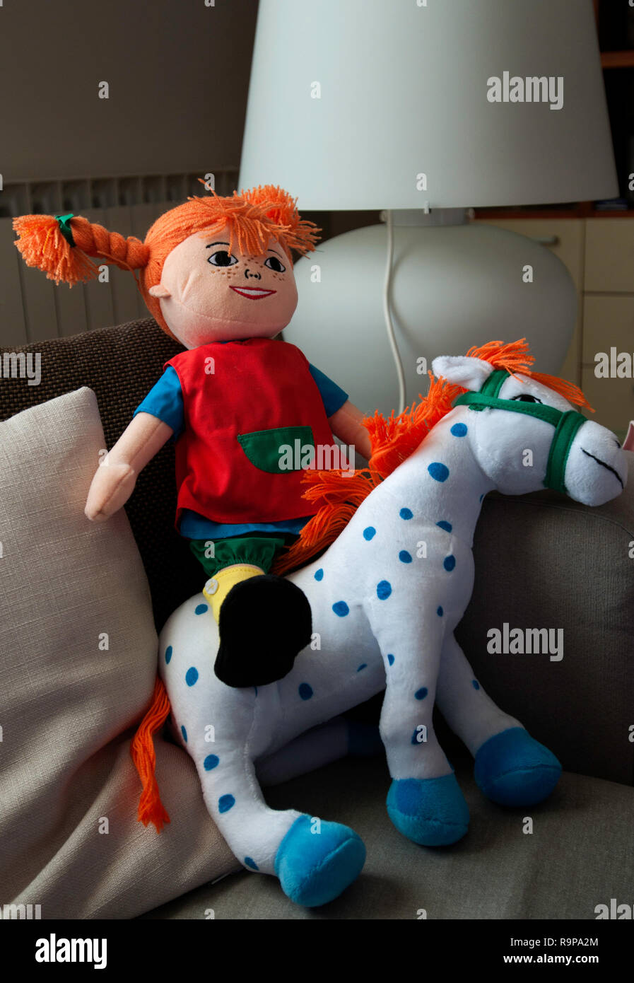 Pippi Longstocking (pippi Calzelunghe) doll on a sofa - Stock Image