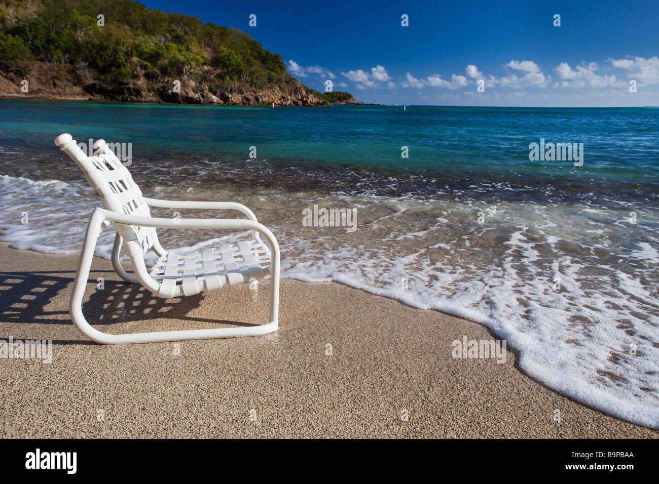 A seat on the waters edge Stock Photo