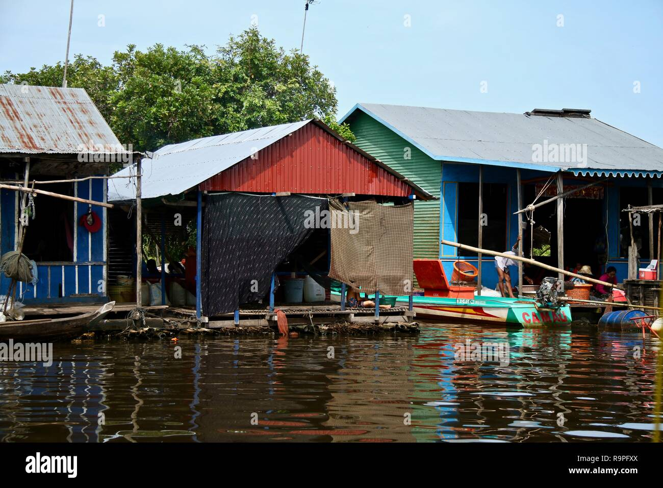 Floating homes at a floating village in Asia - Stock Image