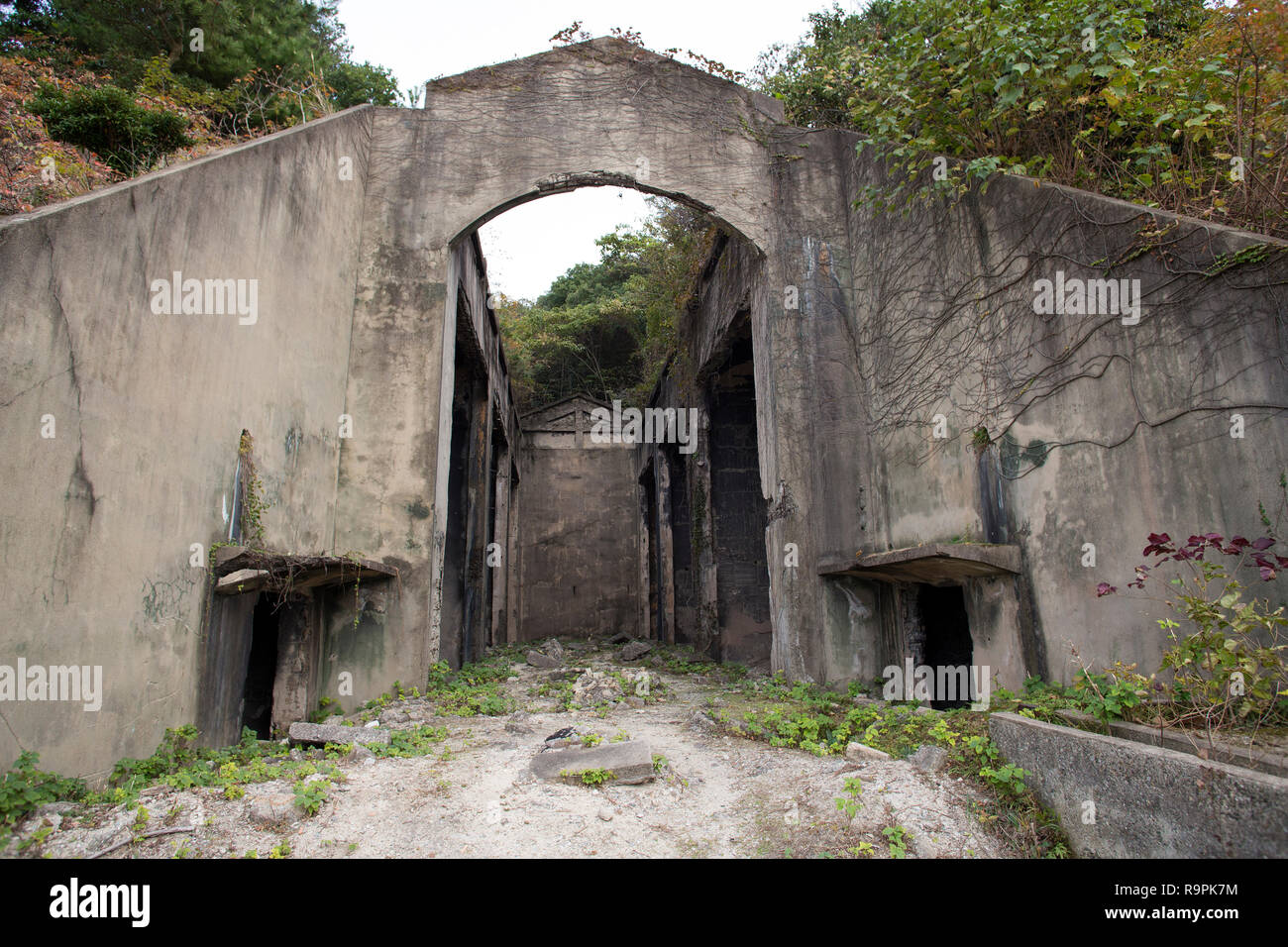 The ruins of Nagaura gas poison storage warehouse in Okunojima island in Takehara, Hiroshima, Japan.  Photo by Akira Suemori - Stock Image