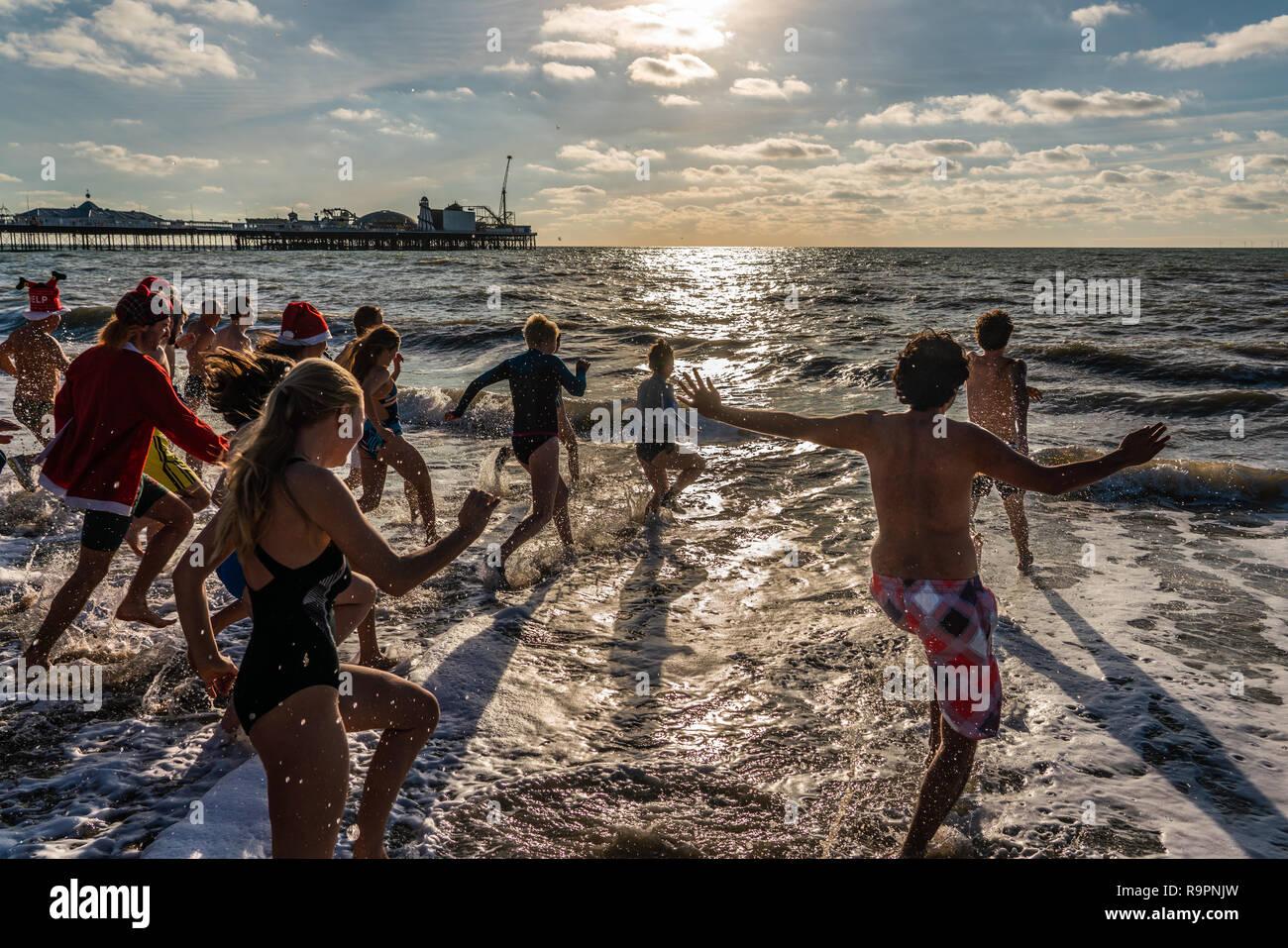 Brighton Christmas day swim charge Stock Photo