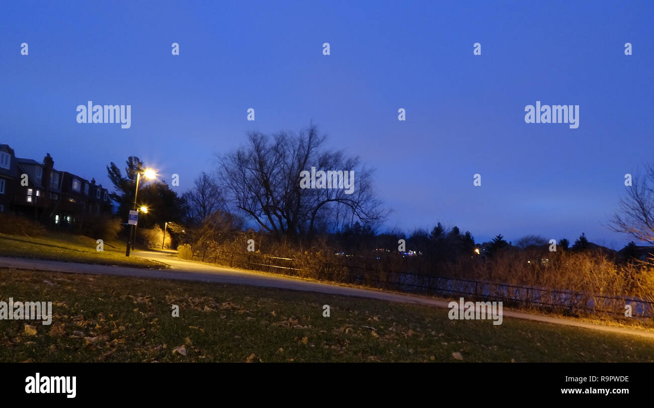 An assortment of shots of a local park taken during the blue hour. - Stock Image
