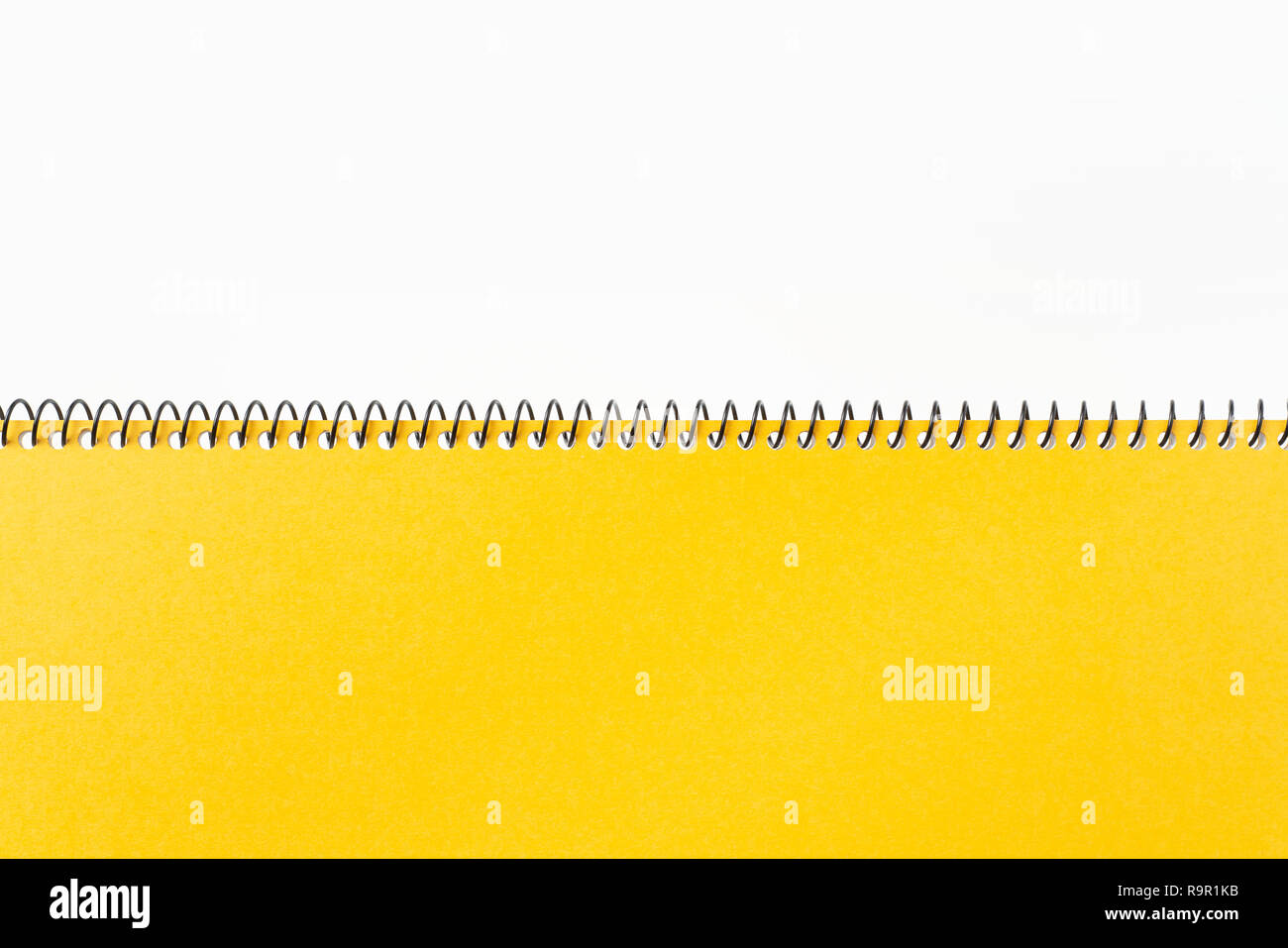 Design concept - Top view of yellow spiral notebook with geometric layout and vintage style for design mockup Stock Photo