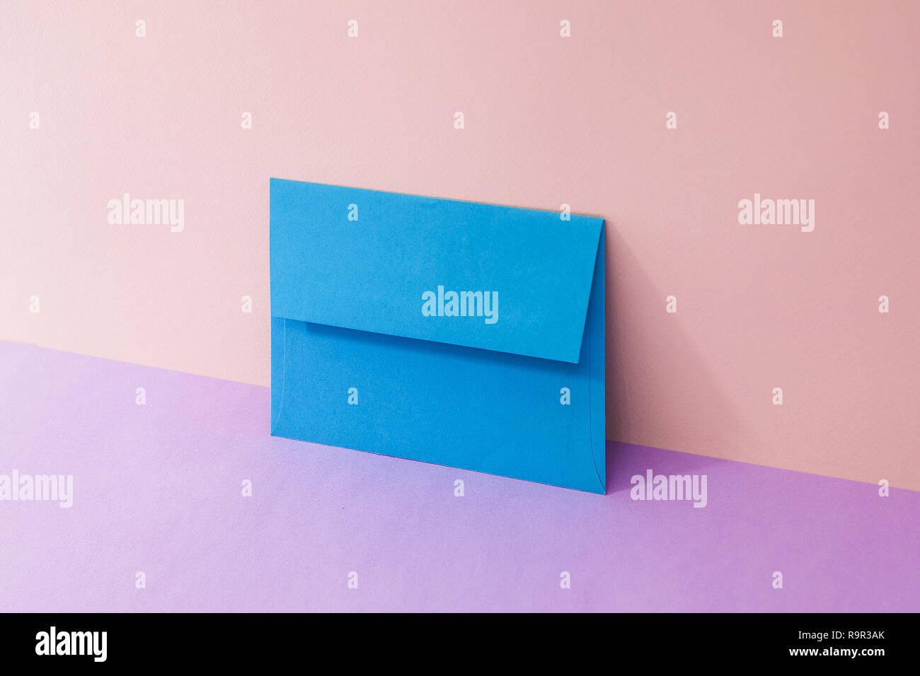 envelope. Pink Two Tone Background. - Stock Image