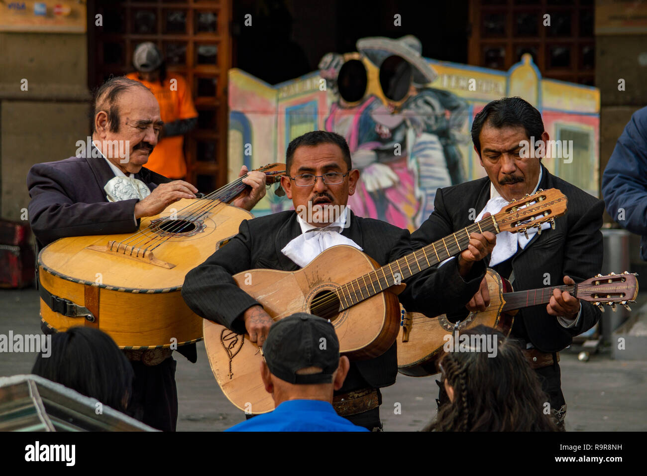 A Mariachi band performing at Plaza Garibaldi in Mexico City, Mexico - Stock Image