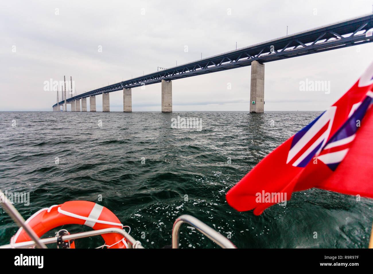 Oresundsbron. The Oresund bridge link between Denmark and Sweden, Europe, Baltic Sea. View from sailboat yacht under uk british ensign. Traveling. Stock Photo