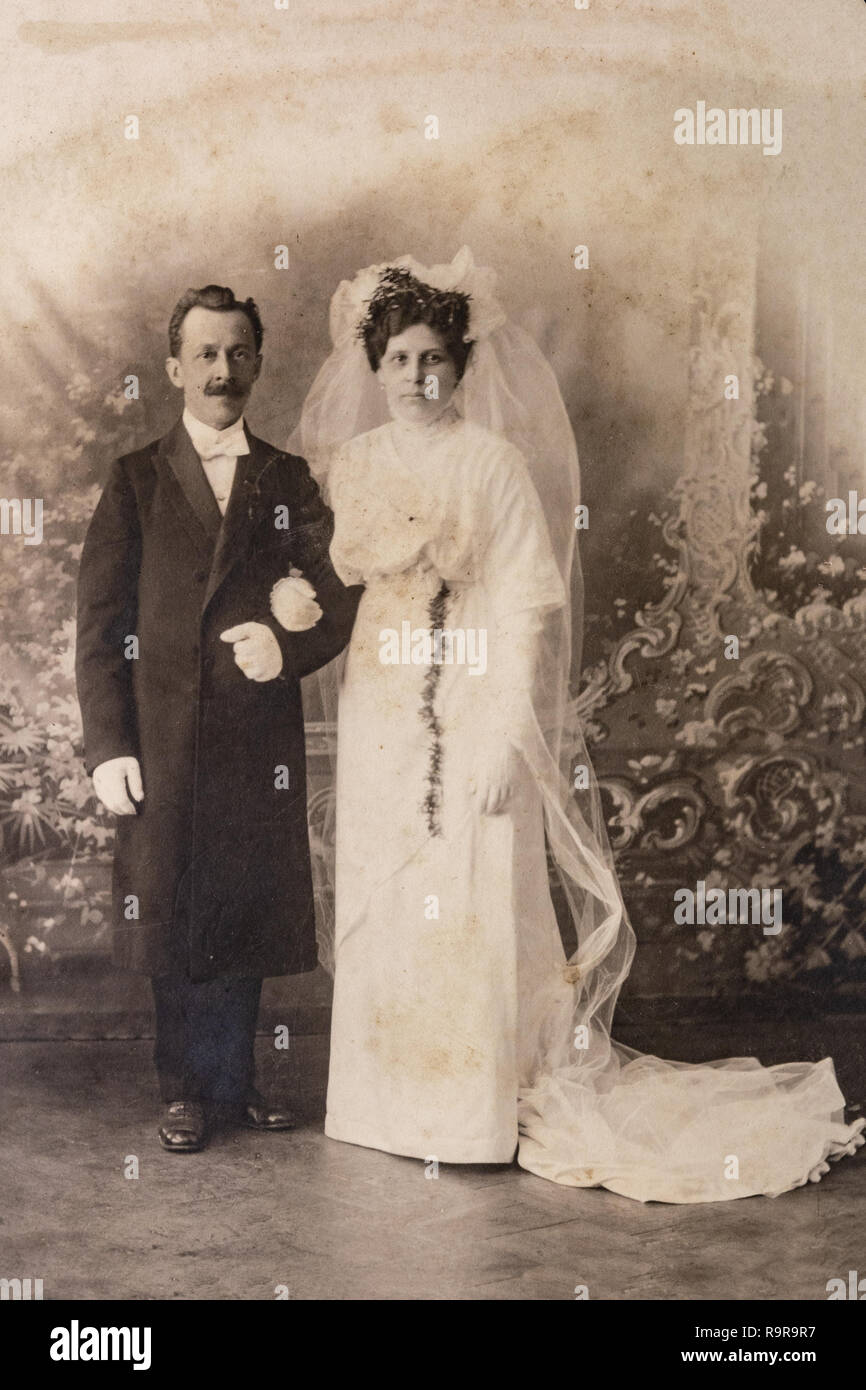 219181d9d5d5 RUSSIA - CIRCA 1905-1910: Wedding shot of just married couple in studio,