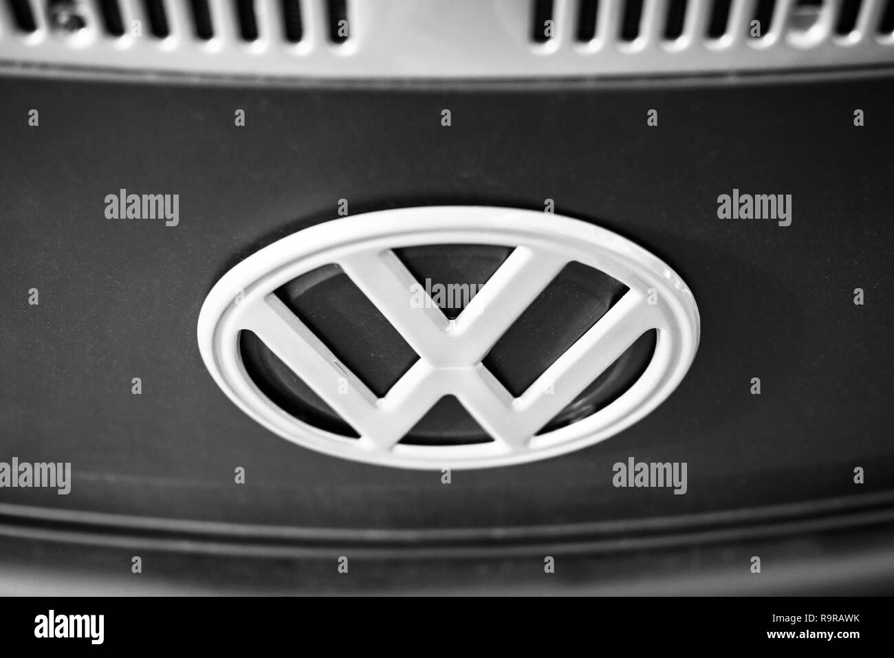 A Volkswagen VW badge on the front of a campervan. - Stock Image