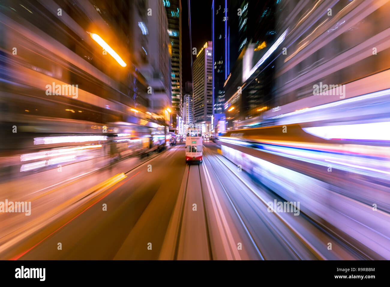 Blurred Motion Travel in Business District of Hong Kong - Stock Image