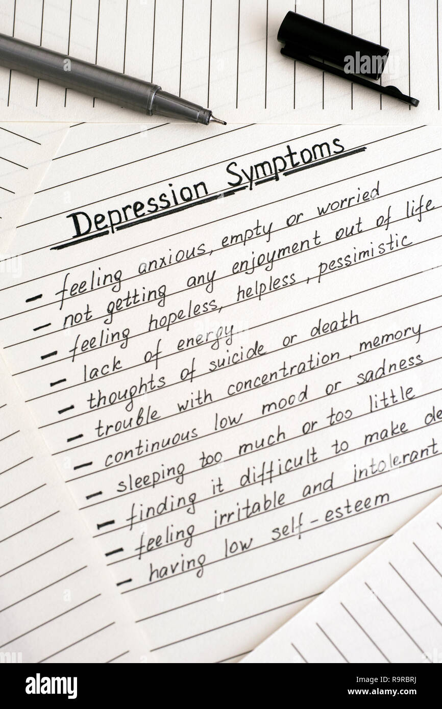 Depression Symptoms writing on the list and black pen. Close-up. - Stock Image