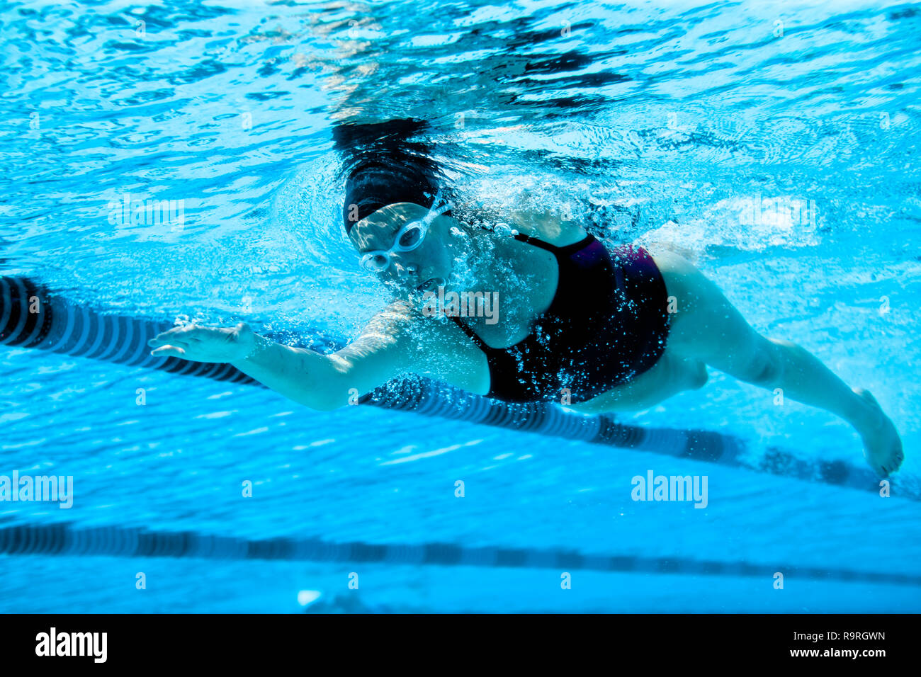 Female swimmer swimming the front crawl. - Stock Image