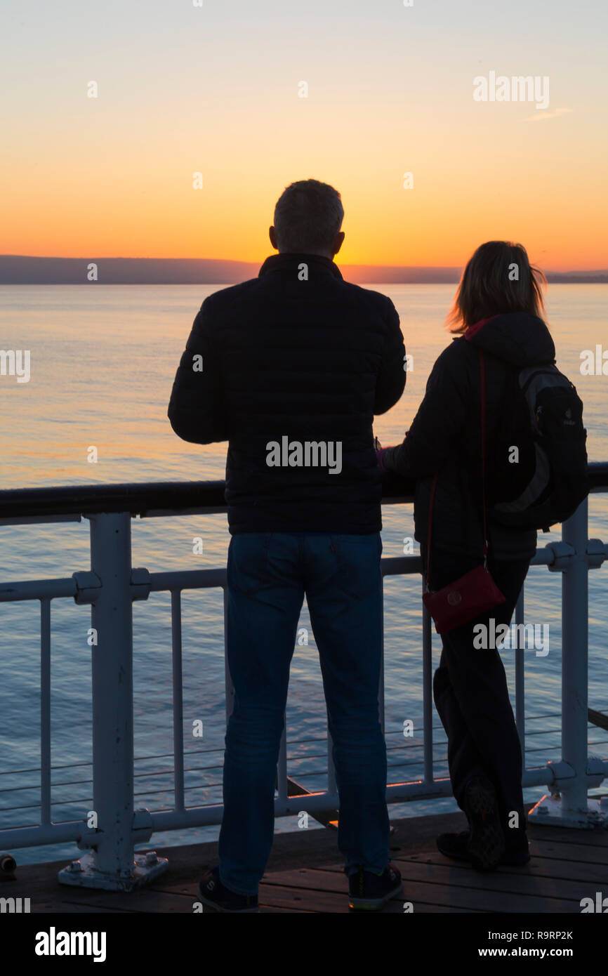 Bournemouth, Dorset, UK. 27th Dec, 2018. Beautiful sunset over Bournemouth beach at the end of a lovely sunny day, as visitors head to the pier and beach to watch the sun go down. Credit: Carolyn Jenkins/Alamy Live News Stock Photo