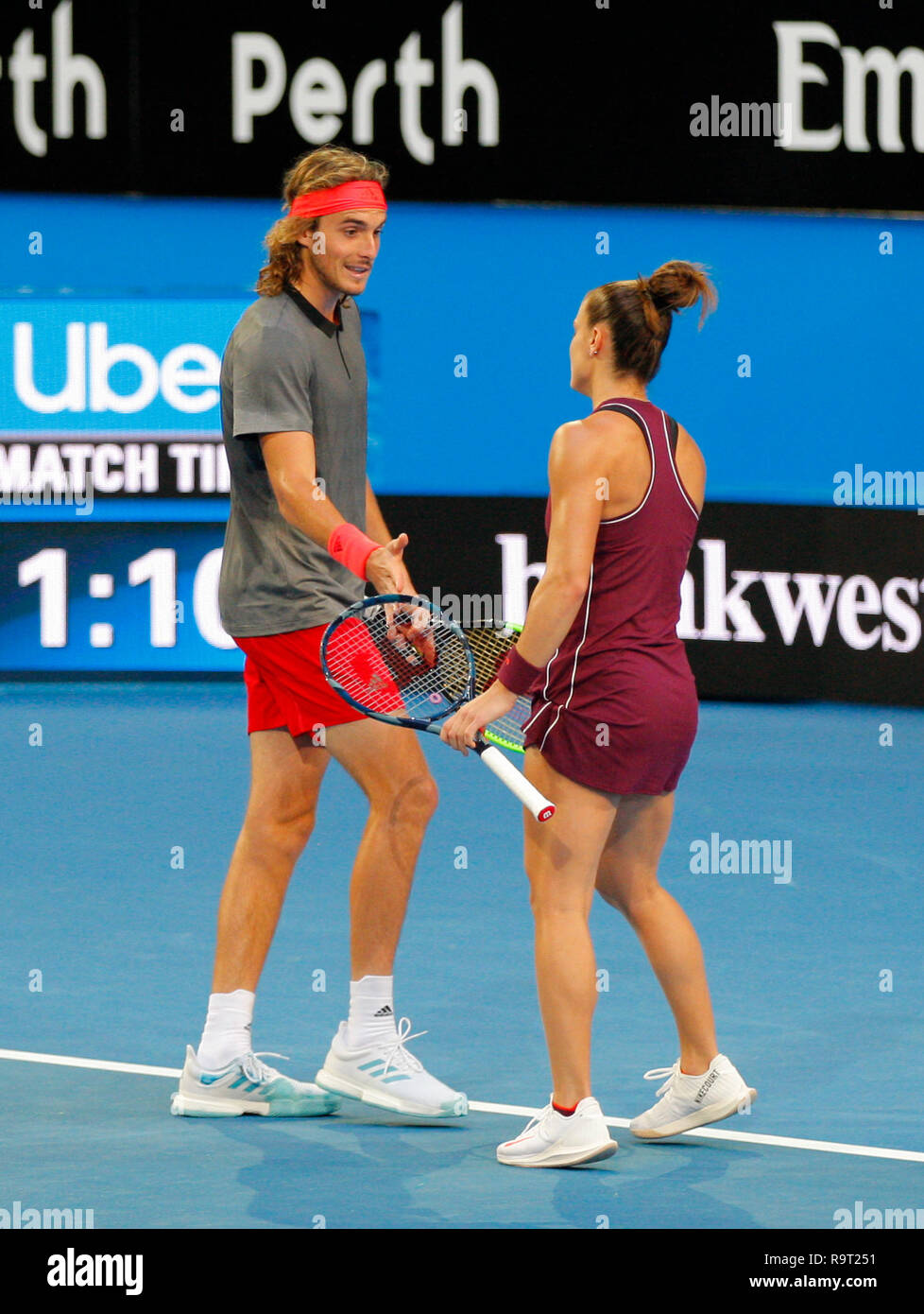 RAC Arena, Perth, Australia. 29th Dec, 2018. Hopman Cup Tennis, sponsored  by Mastercard; Stefanos Tsitsipas and Maria Sakkari of Team Greece come  together during the mixed doubles against Team Great Britain Credit: