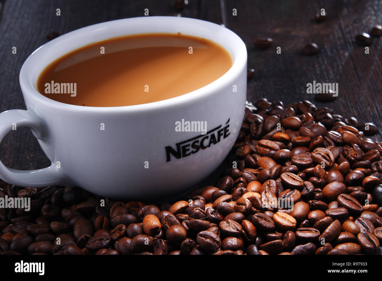 POZNAN, POLAND - AUG 3, 2018: Cup of Nescafe coffee, a brand of Swiss coffee made by Nestle, introduced in 1938 - Stock Image