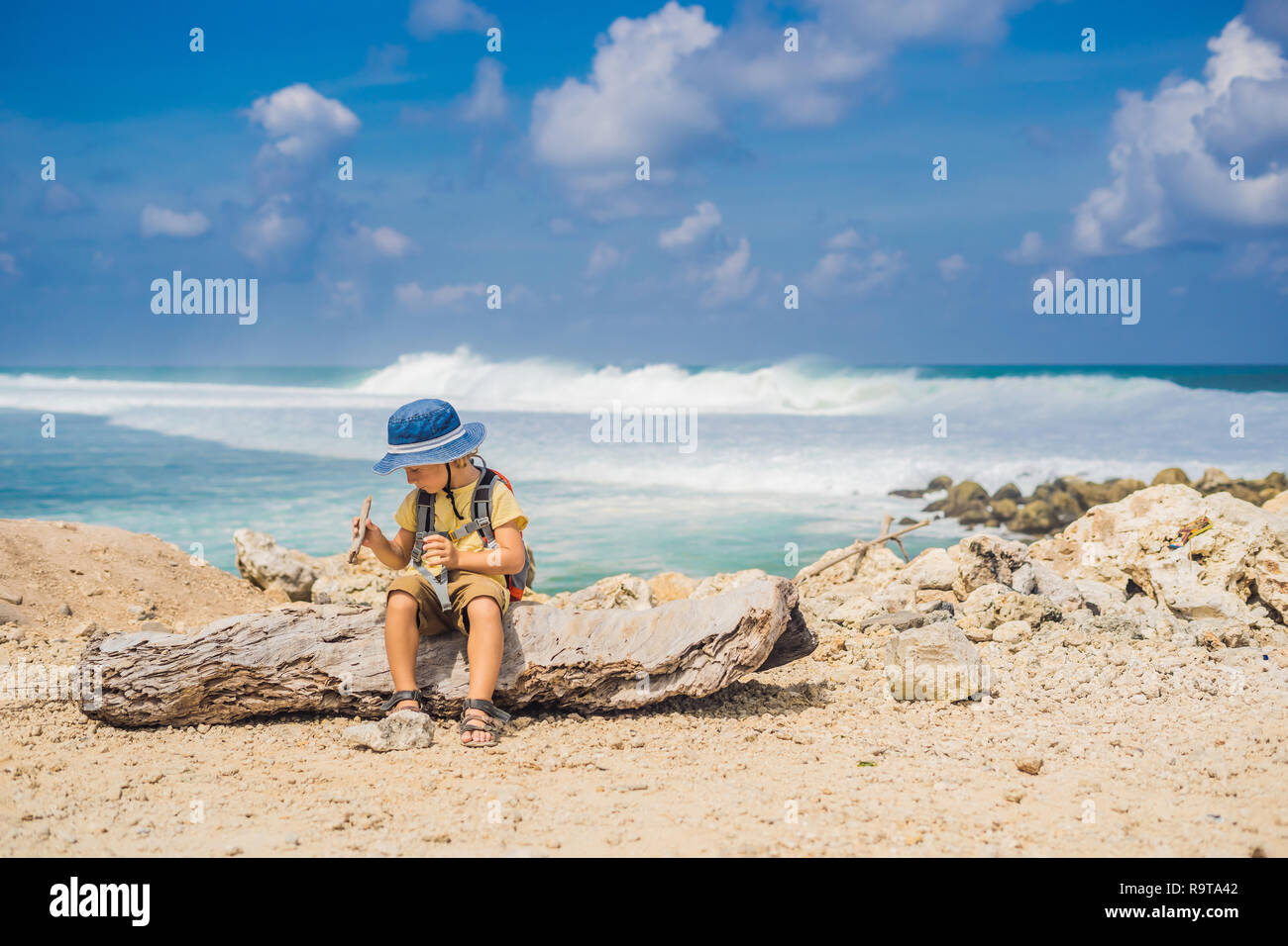 Boy Traveler On Amazing Melasti Beach With Turquoise Water Bali