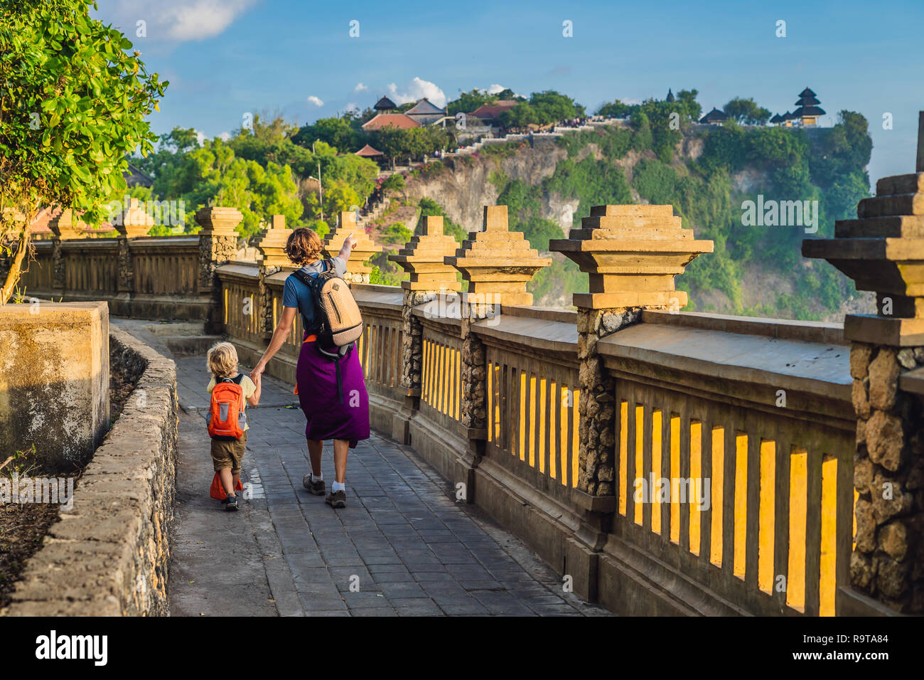 Dad And Son Travelers In Pura Luhur Uluwatu Temple Bali Indonesia Amazing Landscape Cliff With Blue Sky And Sea Traveling With Kids Concept Stock Photo Alamy