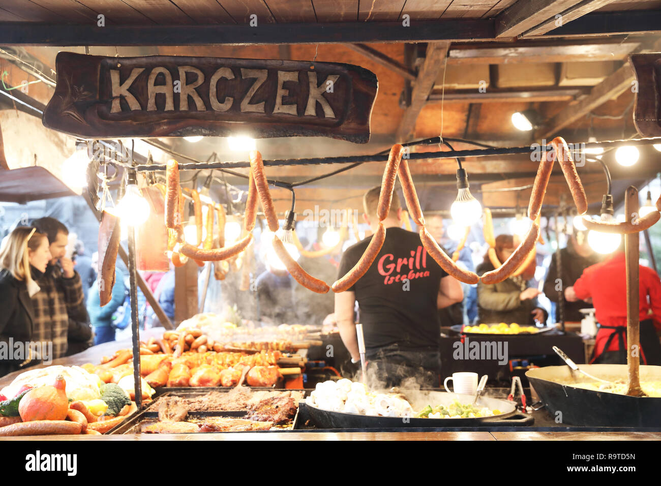 Food stalls on the Christmas market in the Main Market Square, in the Old Town in Krakow, Poland - Stock Image