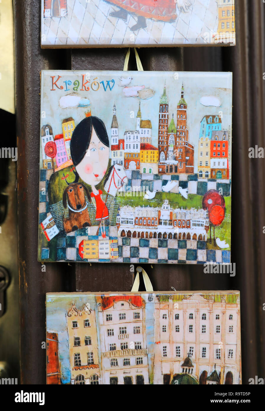 Pretty, local ceramic tiles for sale on stalls on the Christmas market in the Main Market Square, in the Old Town in Krakow, Poland - Stock Image