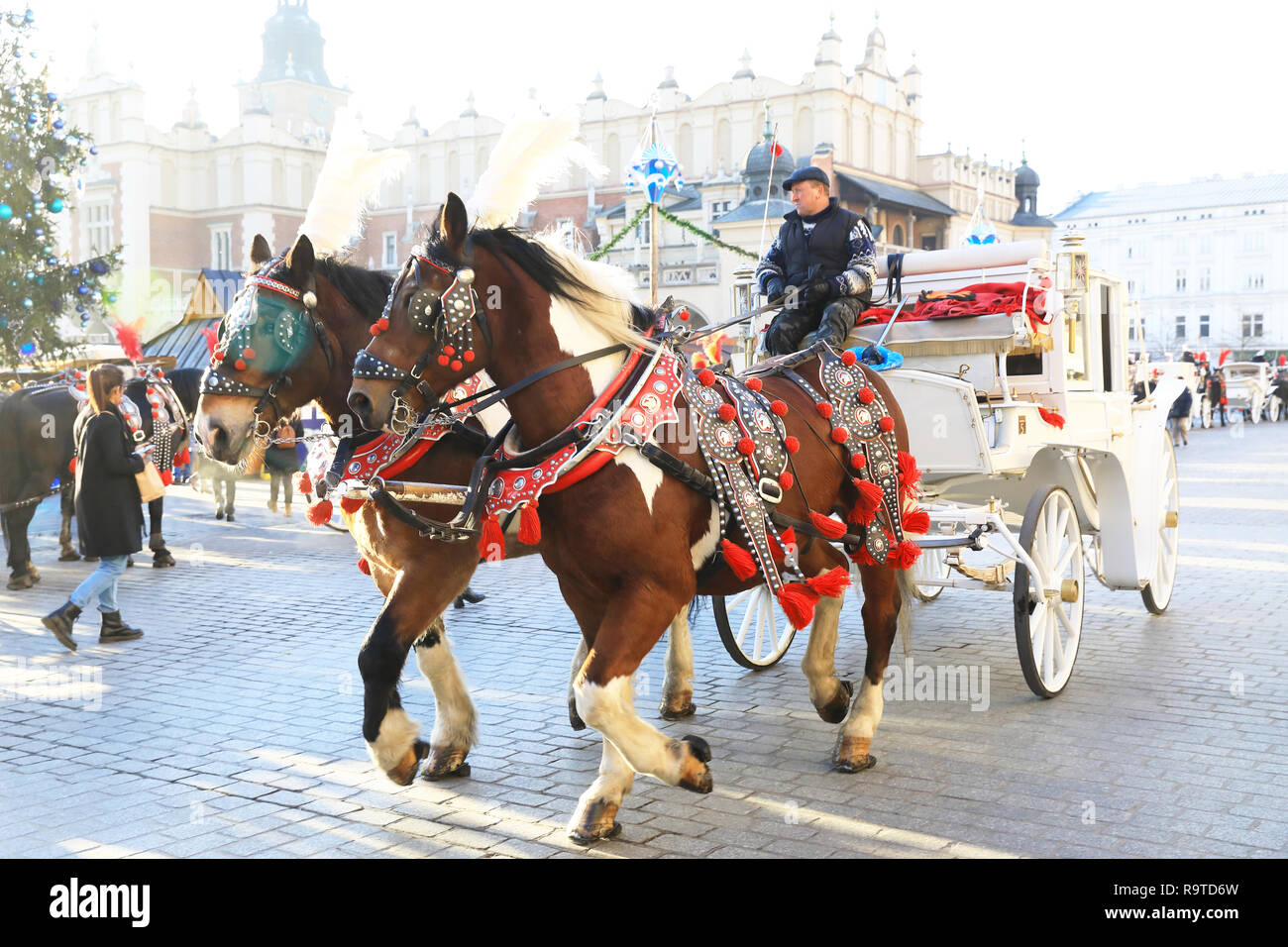 Popular Horse And Carriage Rides Around The Old Town In Krakow At Christmas Time In Poland Europe Stock Photo Alamy
