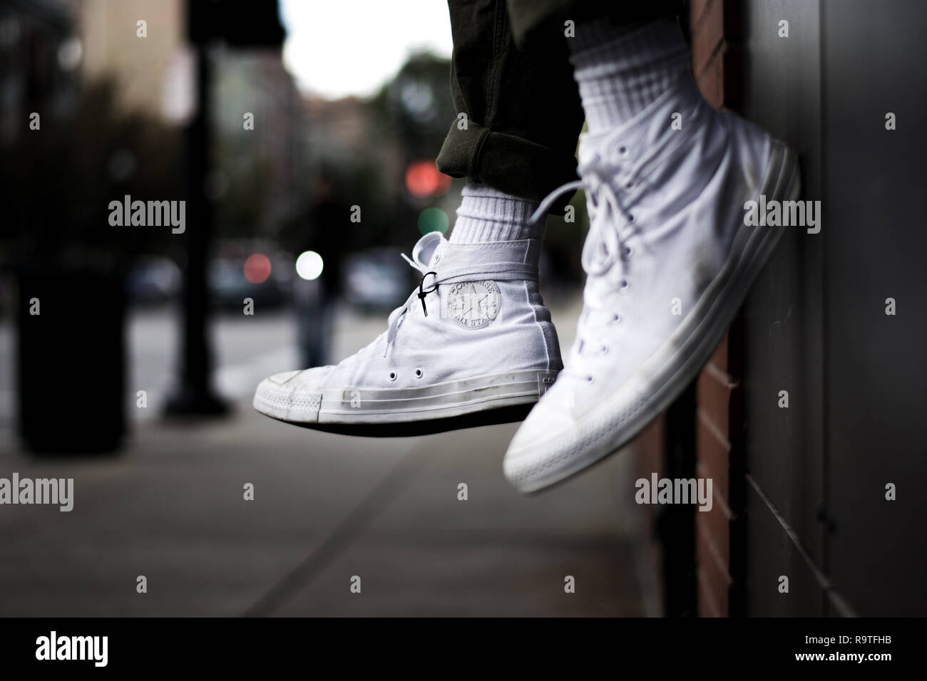 White Chuck Taylors in the city Stock Photo