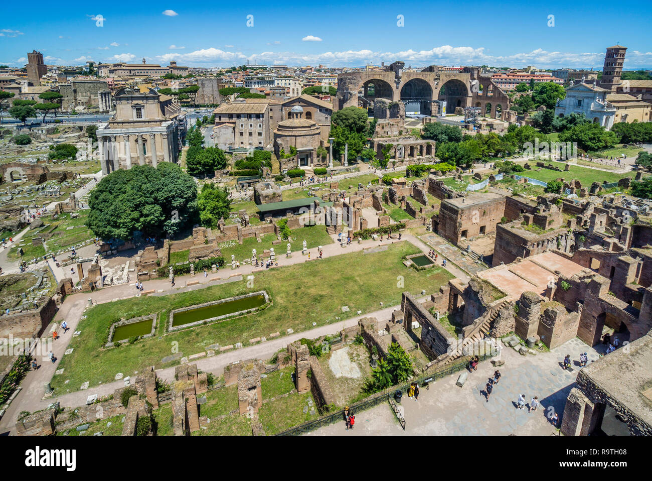the Roman Forum with view of the remains of the House of the Vestals, the Via Sacra, the Temple of Romulus, the remaining nave Basilica of Maxentius - Stock Image