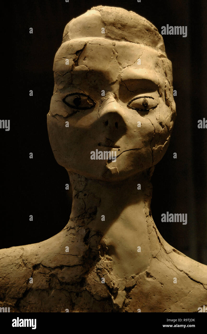 Ain Ghazal statue. Statue of human form. Ain Ghazal, Jordan. Lime plaster, eyelids and pupils in bitumen. c. 6500-7200 BC. Pre-pottery Neolithic B period. Louvre Museum. Paris. France. - Stock Image