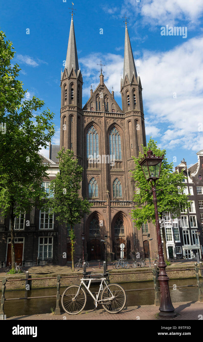Facade of the Neo-Gothic Roman Catholic church called De Krijtberg Kerk. Due to space limitations it is unusually tall church with a monumental front. - Stock Image