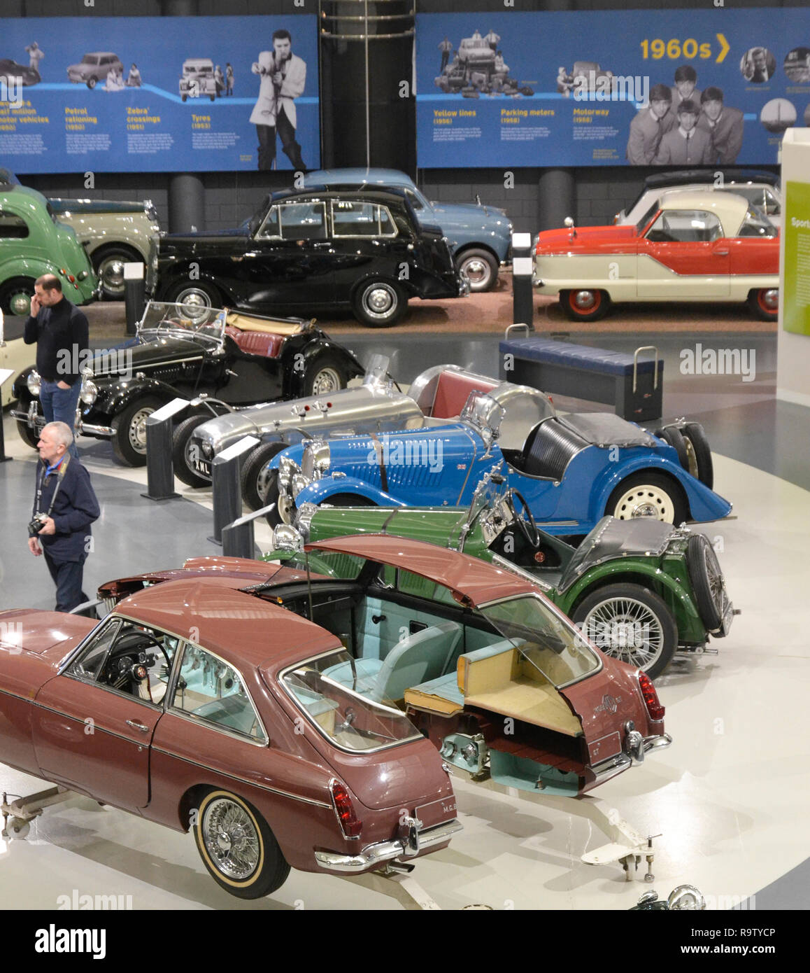 View of classic sports cars in the British Motor Museum, Gaydon, Warwickshire, UK. There's an MG cut in half among the collection. - Stock Image