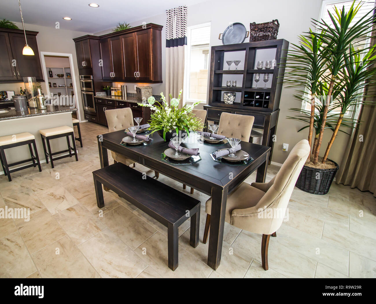 Modern Eating Area Off New Kitchen With Island - Stock Image