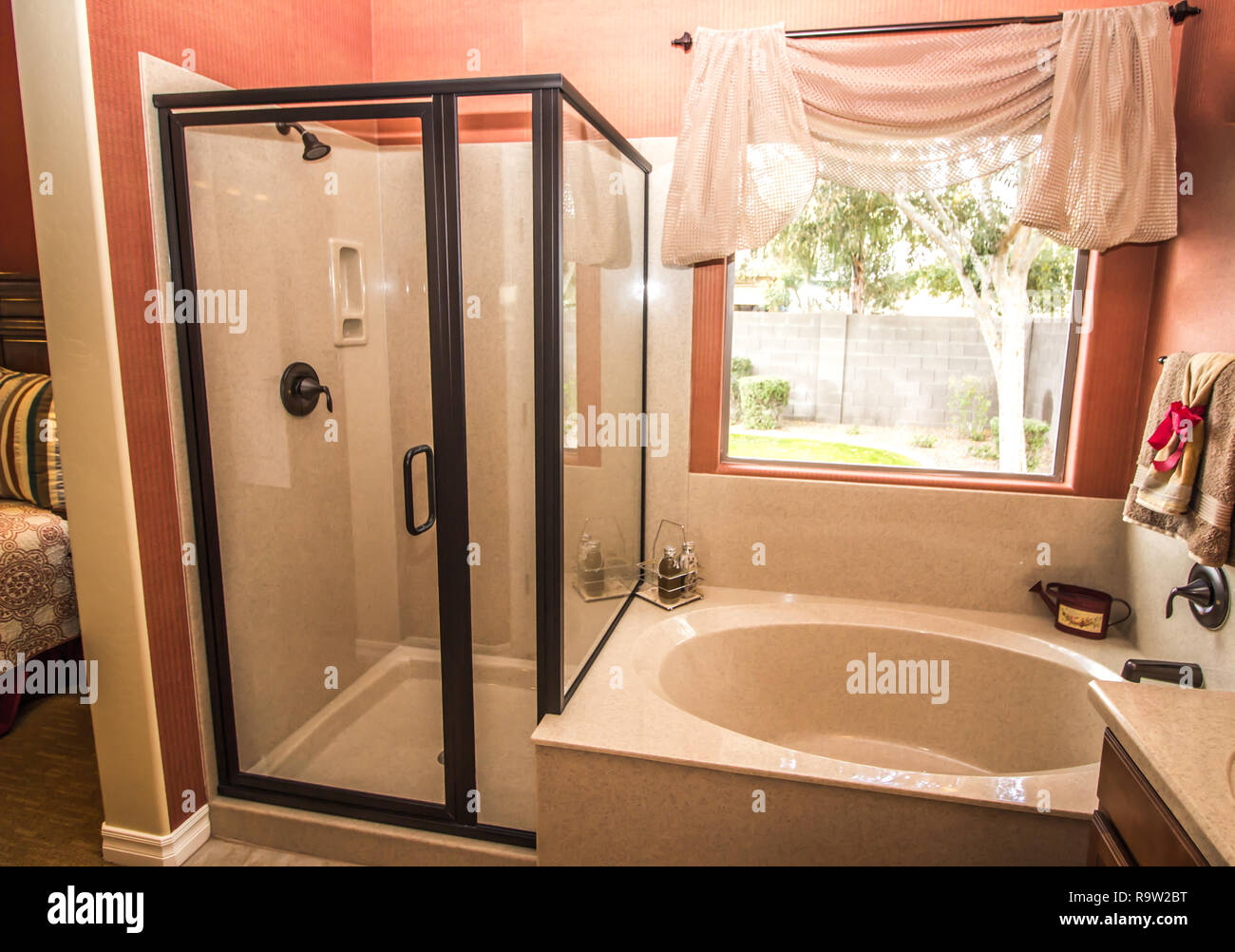 Coral Colored Bathroom With Shower And Bathtub Stock Photo