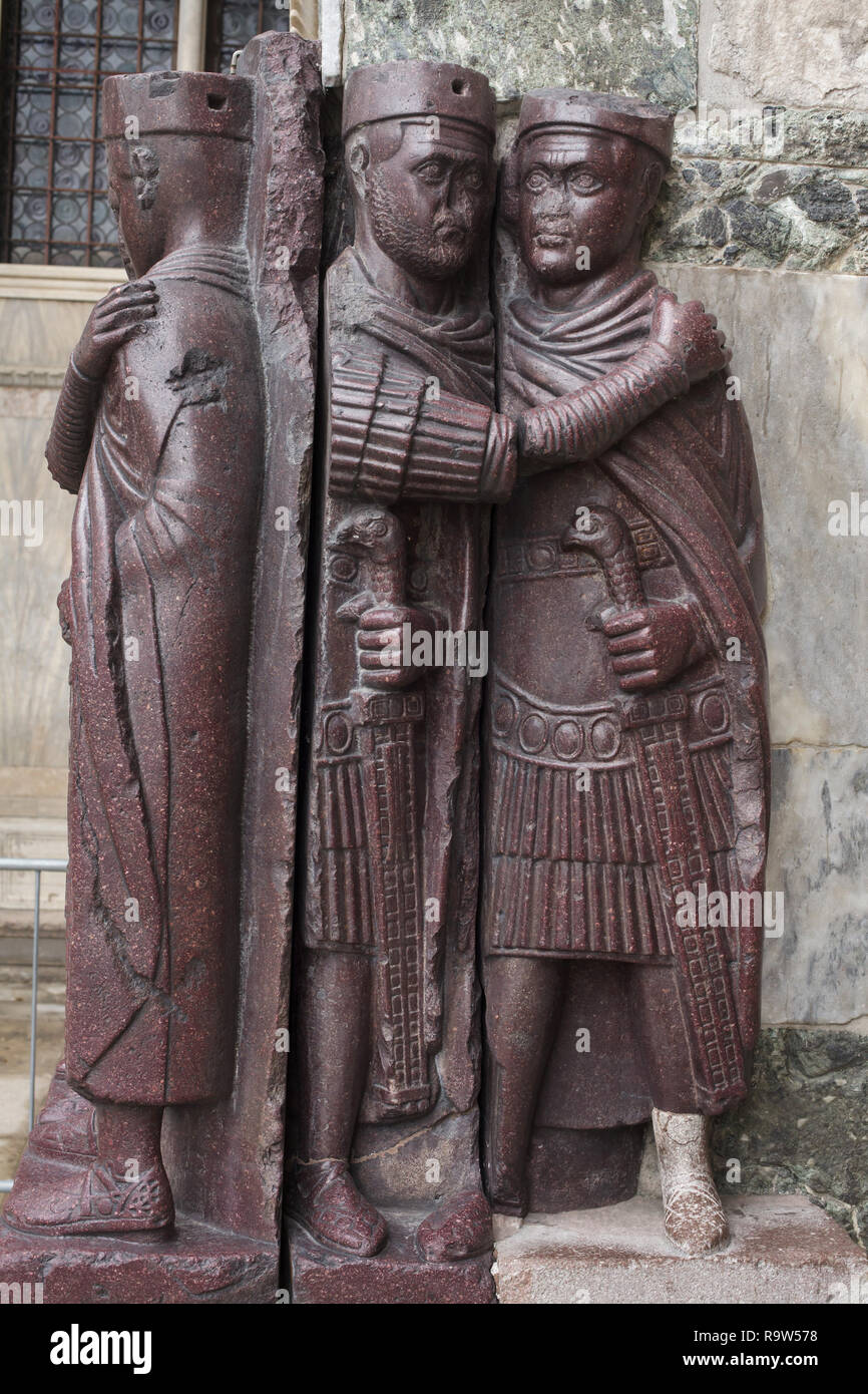 Portrait of the Four Tetrarchs. Porphyry sculptural group of four Roman emperors dated from around 300 AD fixed to a corner of the façade of Saint Mark's Basilica (Basilica di San Marco) in Venice, Italy. Stock Photo