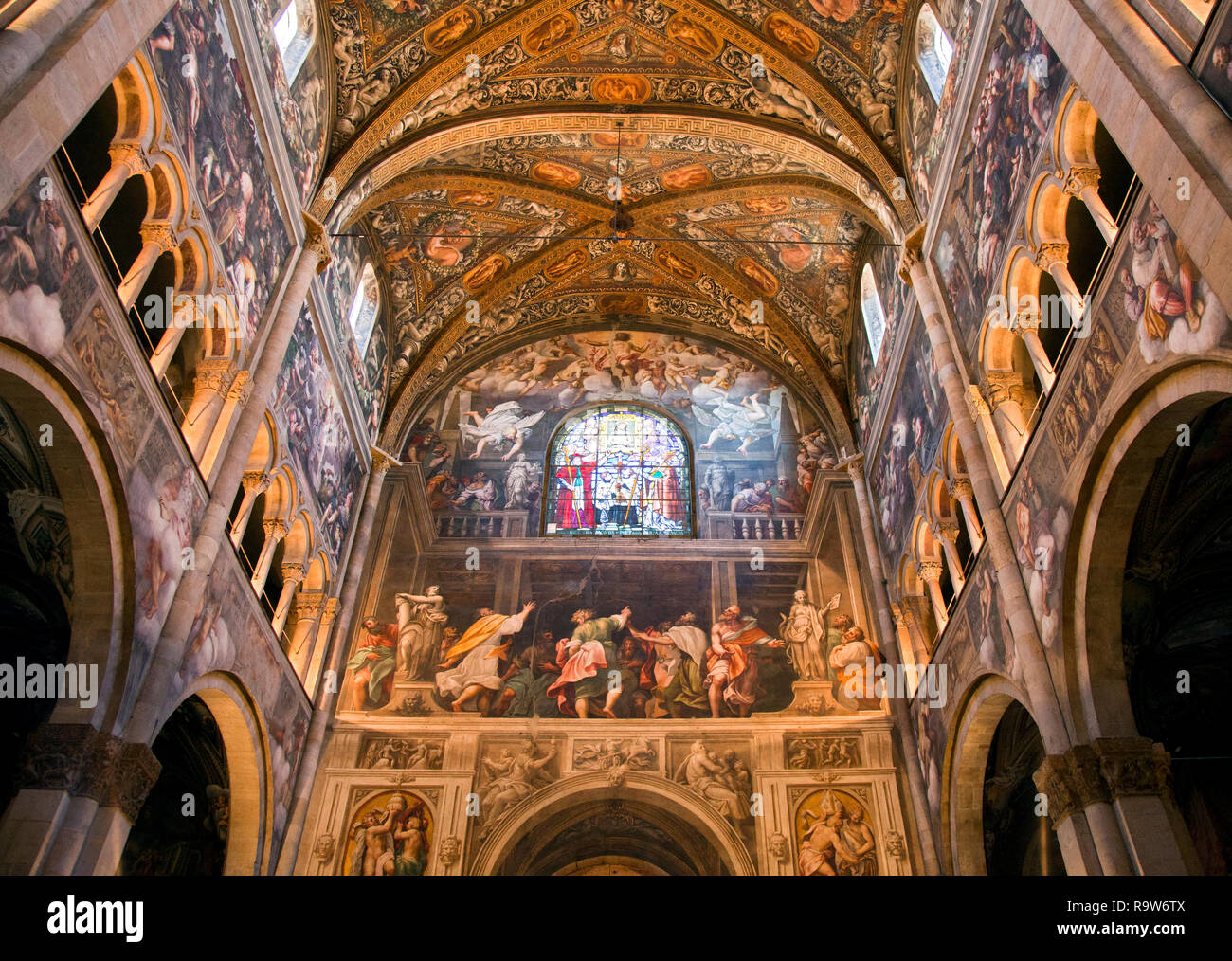 Parma Cathedral, Italy. Along the nave, in the lunettes above the spans are monochrome frescoes of Old Testament stories, as well as event of the pass - Stock Image