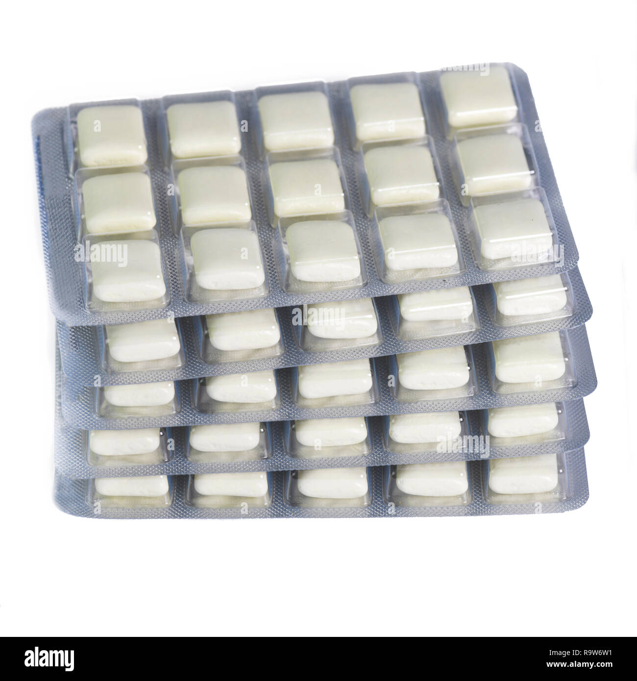 stack of nicotine gum for giving up smoking for health reasons  isolated on a white background - Stock Image