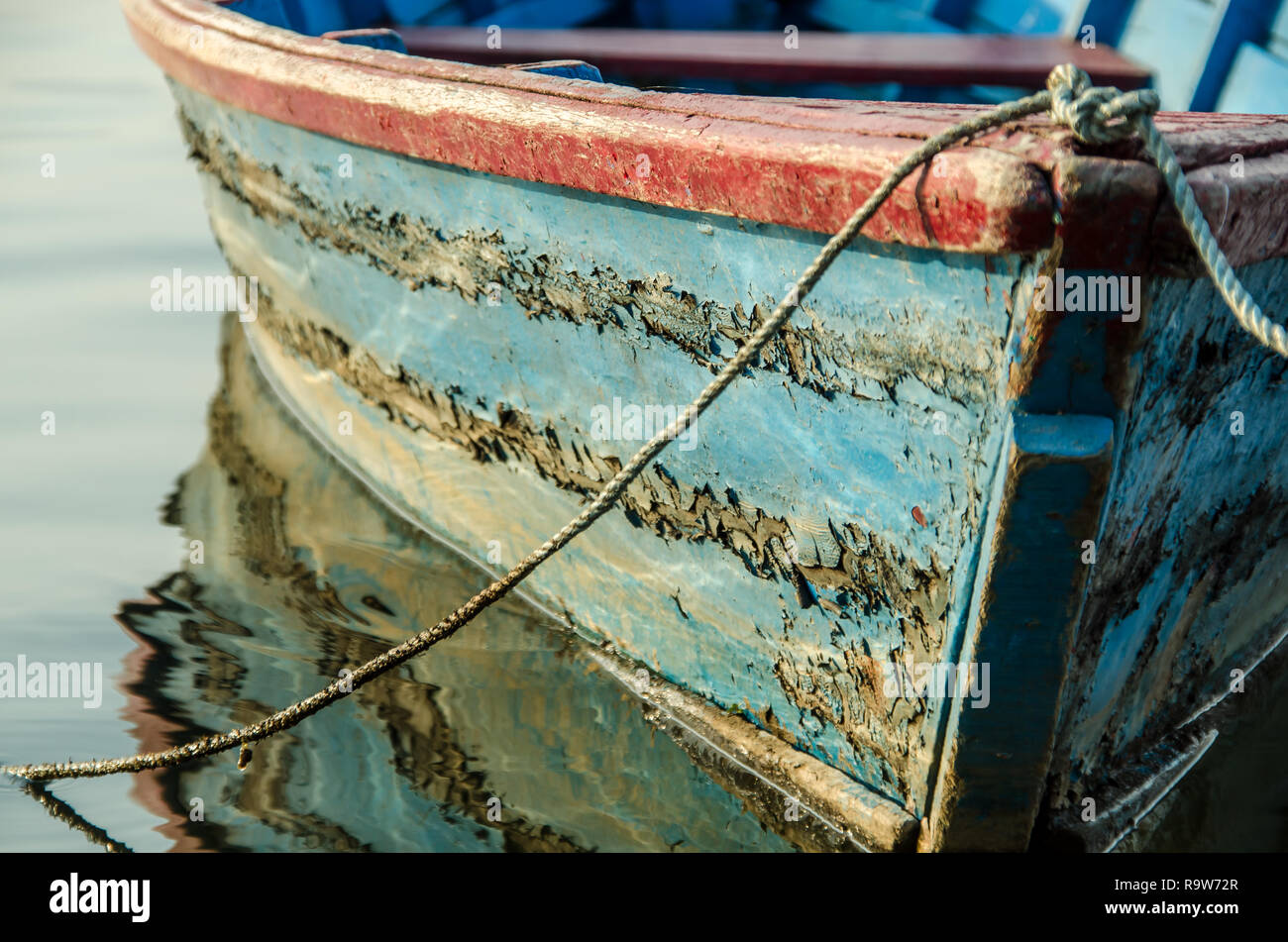 The fishing boats used on the Pokhara lake in Nepal. - Stock Image