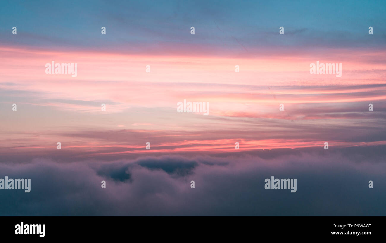 Tirana/Albania-03 02 2019: Quite sunset. Fluffy clouds against colored blue and magenta sky. - Stock Image