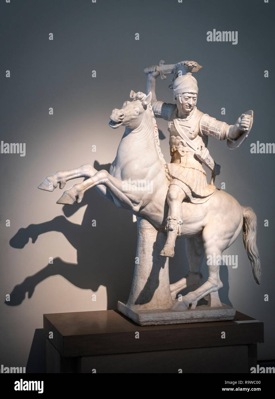 A marble sculpture of a Warrior on horseback. A 2nd cen. AD Roman copy of a 2nd cen BC Greek sculpture. In the National Archaeological Museum at Naple Stock Photo