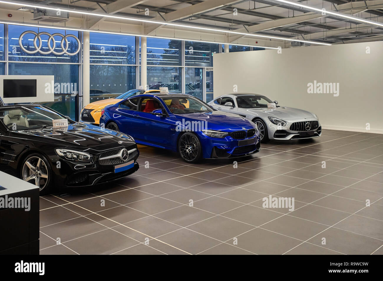 Very expensive cars on show at Jacksons car showroom in Douglas, Isle of Man Stock Photo