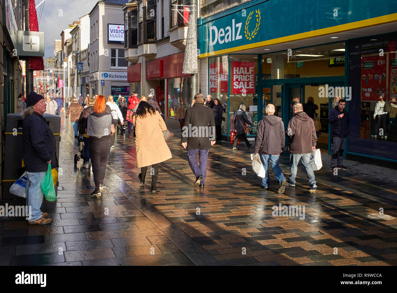Busy Strand Street just before Christmas after a heavy shower of rain in Douglas, Isle of Man - Stock Image