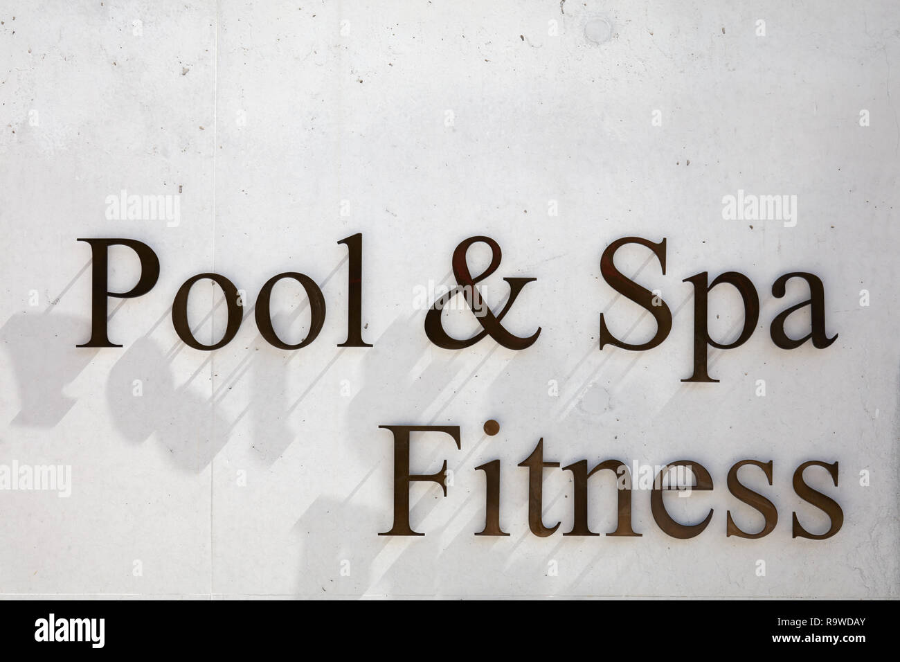 SANKT MORITZ, SWITZERLAND - AUGUST 16, 2018: Pool, spa and fitness writing in metal letters on concrete texture background in Saint Moritz - Stock Image