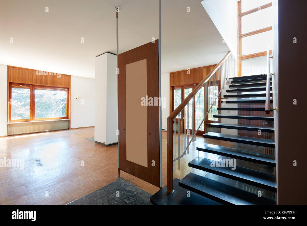 Empty Living Room With Black Marble Staircase Apartment Interior In Old House Stock Photo Alamy