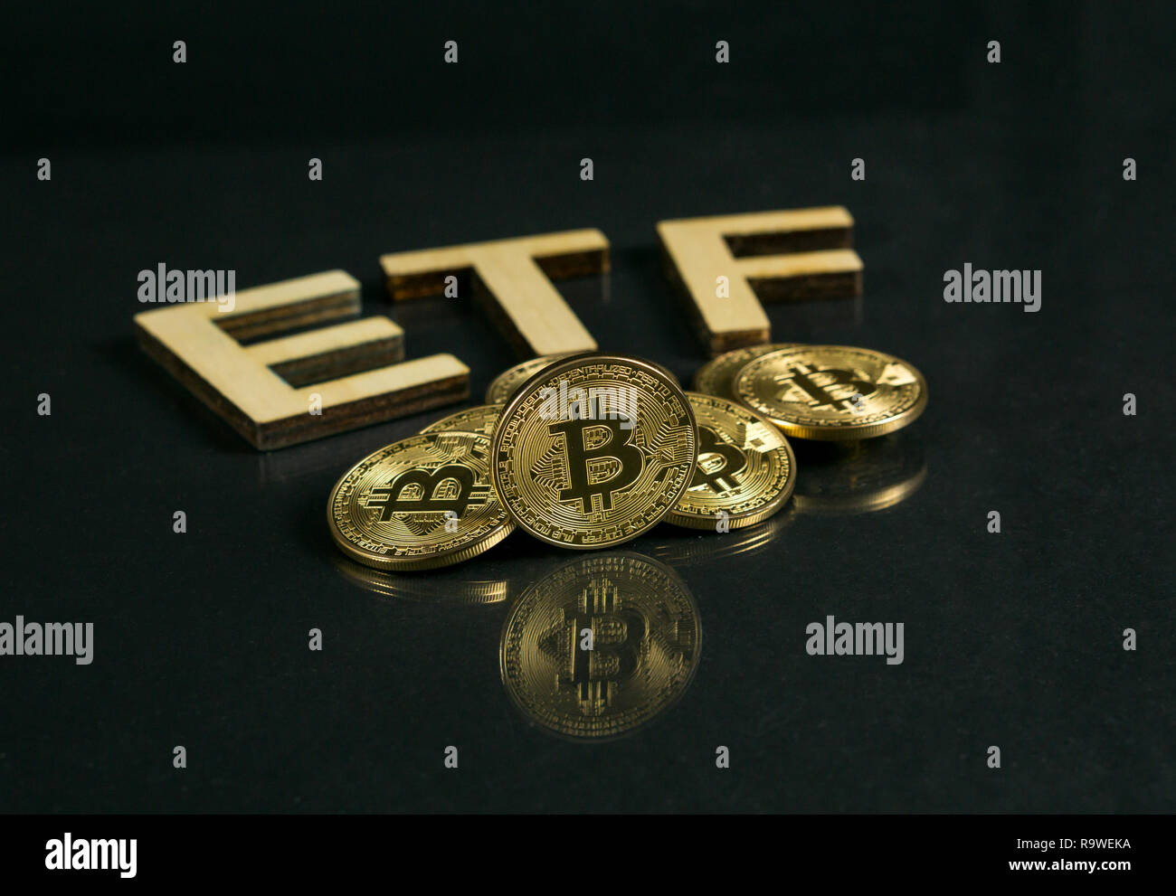 Bitcoin coin with ETF text Put on wooden floor, Concept Entering the Digital Money Fund. Stock Photo