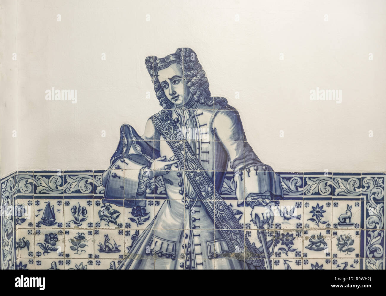 Lisbon - Portugal, gentleman depicted on the facade of an old house with typical hand-painted blue tiles (azulejos) - Stock Image